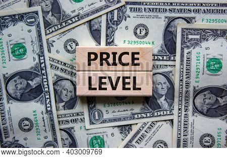 Price Level Symbol. Concept Words 'price Level' On Wooden Blocks On A Beautiful Background From Doll