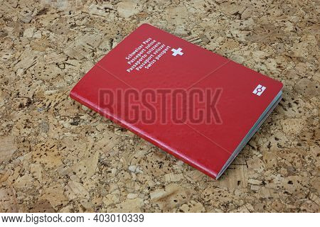 Zurich, Switzerland - January 2, 2021: Swiss Red Passport - National Identity And Citizenship Docume