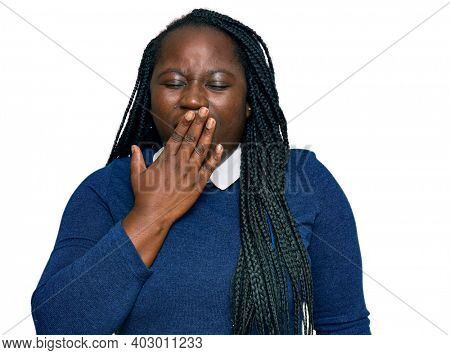 Young black woman with braids wearing casual clothes bored yawning tired covering mouth with hand. restless and sleepiness.