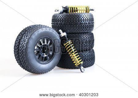 wheels and shock absorbers on a white background