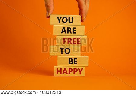 You Are Free To Be Happy Symbol. Male Hand. Wooden Blocks Tower With Words 'you Are Free To Be Happy