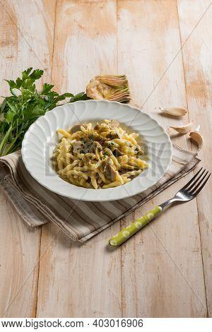 trofie pasta with artichoke and garlic