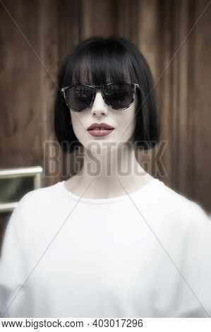 Girl In Fashionable Glasses And Shirt. Look And Retro Style. Parisian Woman With Stylish Short Brune