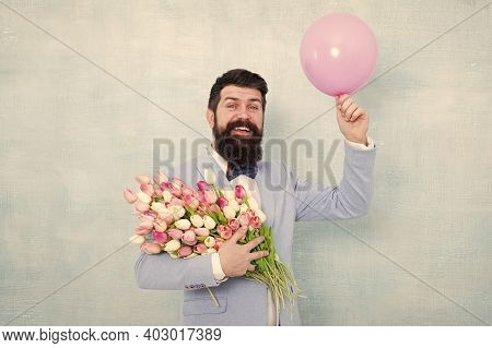 Art Of Charm. Happy Hipster Go Out On Date. Bearded Man Hold Tulips And Balloon. Perfect First Date