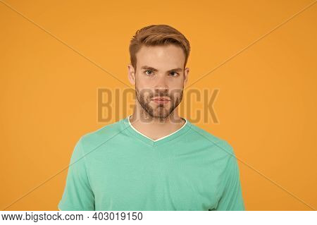 Beauty Standards. Confident Young Man. Man With Bristle On Yellow Background. Male Beauty And Fashio