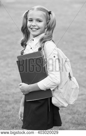 Development Of Imagination. Cute Girl Hold Notebook. Happy Preschool Girl With Book In School Yard.