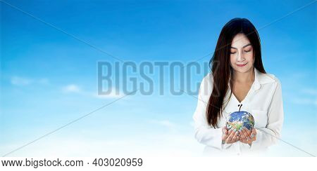 World Food Day Concept: Asian Woman Hands Holding Earth Globe Of Apple Fruit On Blue Sky Background.