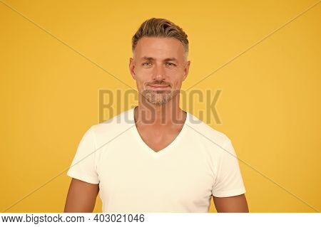 Good Looking Man. Man Yellow Background. Unshaven Man With Stubble Beard And Haircut. Mens Grooming.