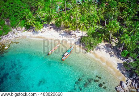 Aerial view of tropical beach and two longtail boats, Sai Nuan, koh Tao, Thailand