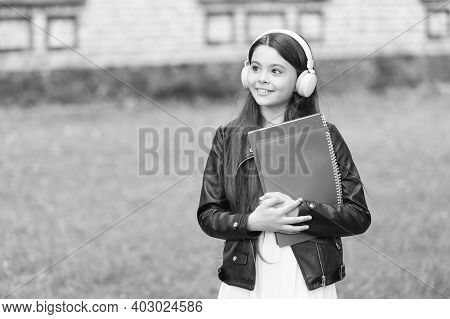 Lesson That Sounds. Small Learner Wear Headphones. Little Child Hold Books For Lesson. Private Lesso