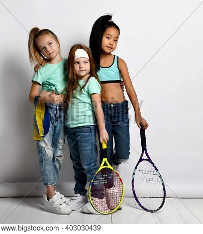 Happy Sportive Kids Enjoy Workout And Healthy Lifestyle. Little Girls Wearing Jeans, Sportive T-shir