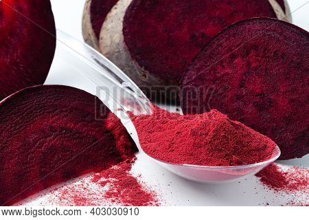 Superfood Beetroot Powder On A White Background. Healthy Eating Concept Dry Beet Powder. Flour Reduc