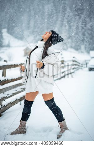 Winter Vacation. Pretty Woman Warm Clothes Snowy Forest. Nature Covered Snow. Having Fun With Snowba