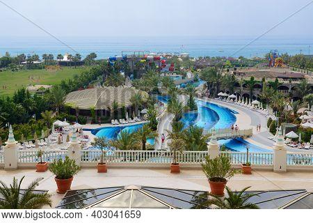 Antalya, Turkey - April 23: The Swimming Pool And Beach With Water Slides At Royal Holiday Palace Lu