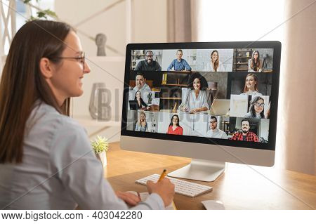 Group Of Diverse Multiracial People On The Laptop Screen, A Young Woman Is Talking With Colleagues,