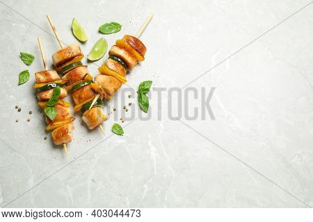 Delicious Chicken Shish Kebabs With Vegetables On Grey Marble Table, Flat Lay. Space For Text