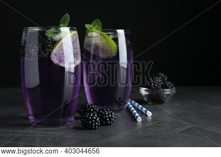 Delicious Blackberry Lemonade Made With Soda Water And Ingredients On Grey Table, Closeup