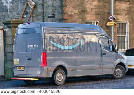 Edinburgh, United Kingdom - January 12 2021: Amazon Prime delivery van parked on the side of the street, during January 2021 lockdown due to vocid19
