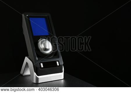 Remote Control Of Audio Speaker System On Black Table. Space For Text
