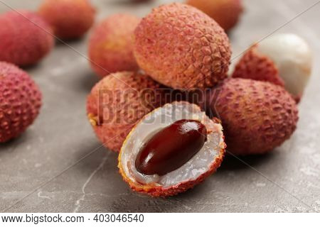 Fresh Ripe Lychee Fruits On Grey Table, Closeup