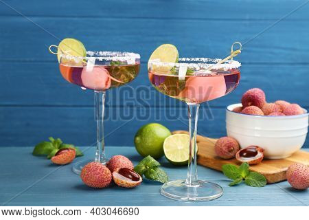 Lychee Cocktail With Lime And Fresh Fruits On Light Blue Table
