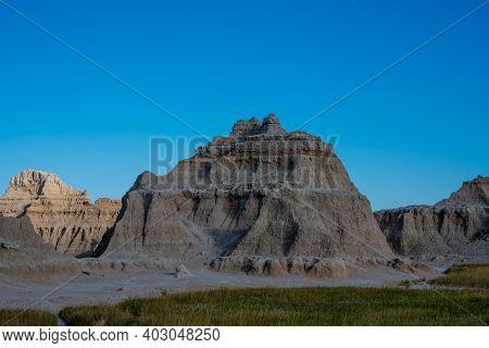 Blue Sky Just After Dawn Over Rock Formation In Badlands National Park