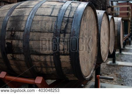 Bourbon Barrels Wait For Transportation To Storage Area