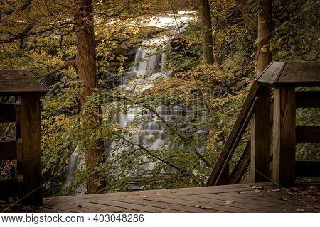 Brandywine Falls Through The Trees From The Observation Deck In Cuyahoga Valley National Park