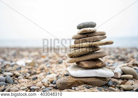 Bright Sky And Flat Stone Cairn Along Shore Of Lake Michigan