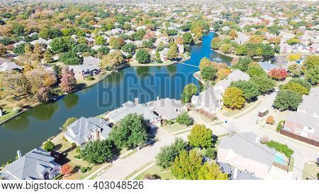 Top View Large Subdivision Sprawl Near Dallas, Texas, Usa With Lakeside Houses And Master Planned Co