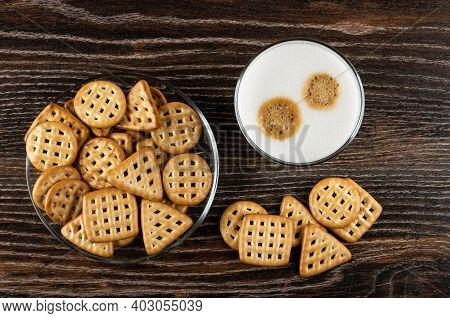 Cookies Triangular, Square And Round Shape In Transparent Saucer, Glass With Latte-macchiato On Dark