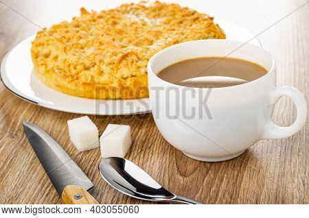 Shortbread Pie With Lemon Filling In White Glass Dish, Kitchen Knife, Sugar Cubes, Teaspoon, Cup Of