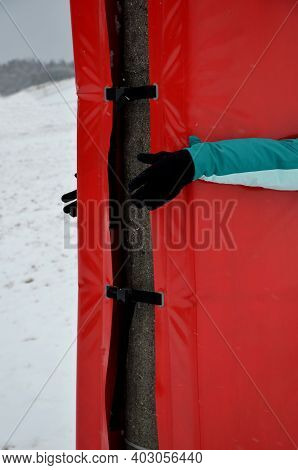 Foam Barrier On A Pole Near The Ski Slope. The Protective Mattress Cover The Pole At The Lift And Th
