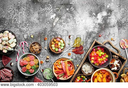 Sweets Candy, Candied Fruits With Marshmallow And Jelly On A Wooden Tray. On A Rustic Background.