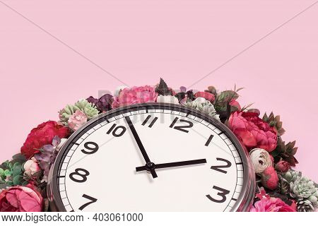 Part Of Wall Clock In Blooming Flowers On Candy Pink Background