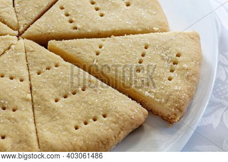 Traditional Scottish shortbread, baked in circle and cut into wedges.  Delicious buttery biscuits.