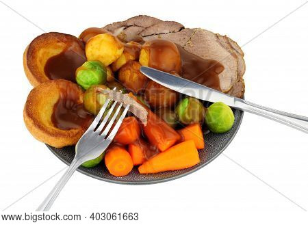 Traditional Roast Beef Dinner With Roasted Potatoes And Yorkshire Pudding And Vegetables, Isolated O