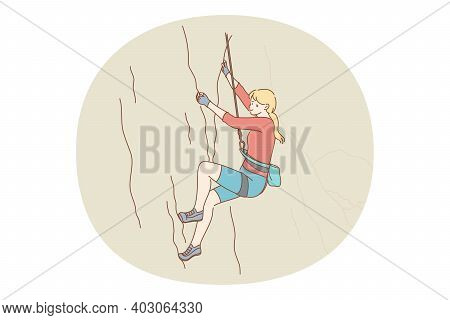 Alpinism And Climbing Concept. Young Girl Athlete Climbing Natural Mountains With Special Equipment