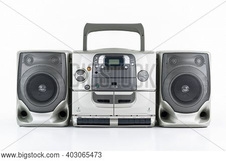 Vintage boom box style portable stereo radio, cd, cassette tape player and recorder on white.
