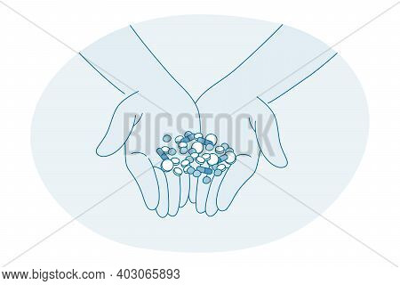 Medical Treatment, Drugs, Pills Concept. Human Hands Holding Assortment Of Medic Pharmaceutical Caps