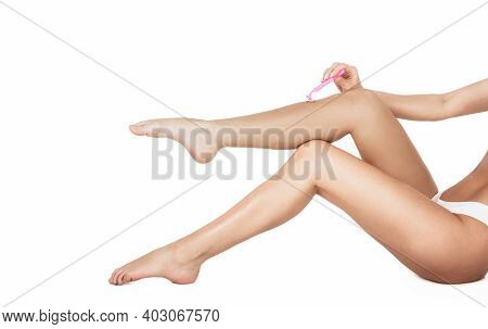 Shaving Legs. Spa, Depilation And Bodycare Concept. Legs Of Healthy Girl Shaving It Carefully. Isola
