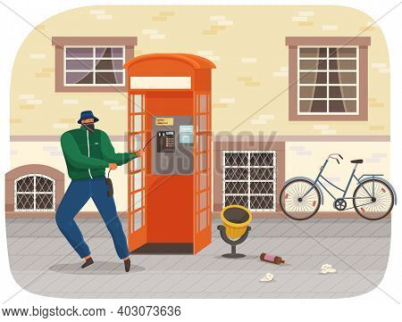 Vandal Damaging The Telephone Booth On The Town Street. Bandit In Mask And Hat Destroy City Property