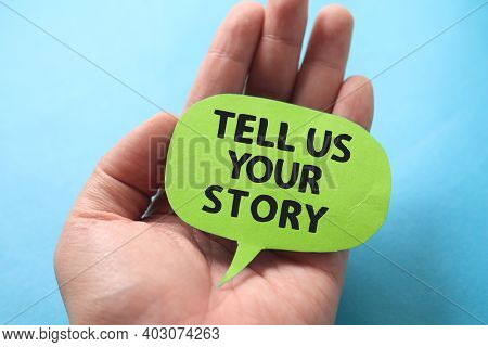 Tell Us Your Story, Text Words Typography Written On Paper Against Blue Background, Life And Busines