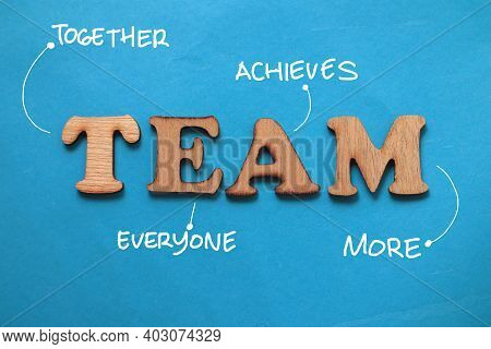 Team Together Everyone Achieves More, Text Words Typography Written On Paper Against Blue Background