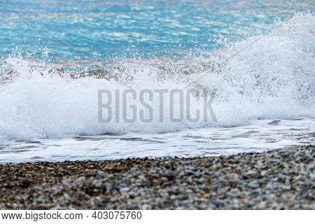 Seashore On Stone Beach. Close Up View.
