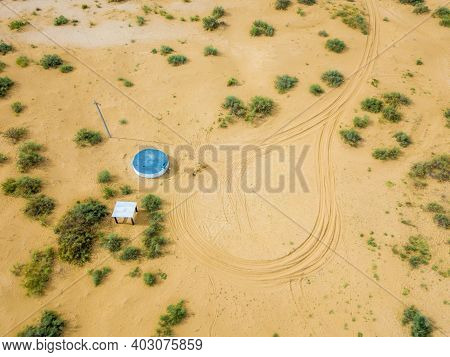 Water Well In The Desert Or Steppe. Place To Turn The Water Delivery Vehicle