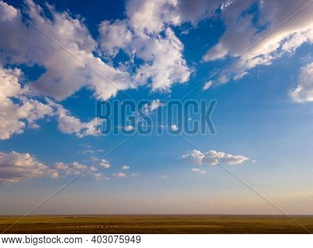 Blue Sky And Clouds With Horizon On Sunset