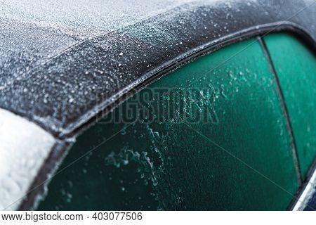 Modern Fabric Convertible Vehicle Roof Covered By Ice And Freezing Rain During Extreme Low Temperatu