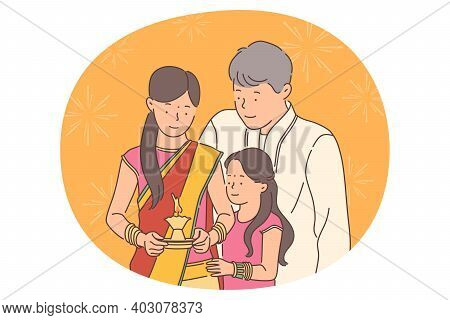 Indian Deepavali Or Diwali Holiday Concept. Happy Indian Family Father Mother And Daughter In Tradit