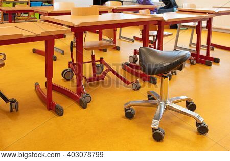 Saddle Chair In A Classroom With Equipment For Disabled Children